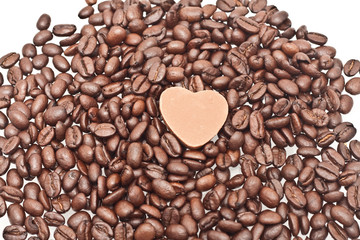 Coffee beans with heart shape chocolate sweet