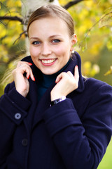 Russian beauty - the happy girl at a white birch.