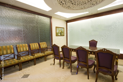 conference room table with leather chars.