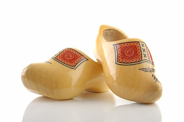 Pair of traditional Dutch wooden shoes over white background