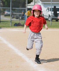 Girl running in baseball