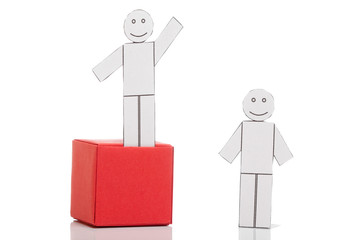 Toy men on boxes