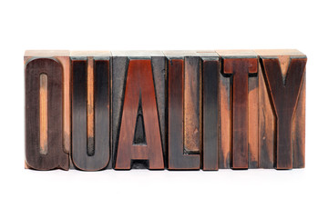 Quality - old wooden letterpress type, isolated