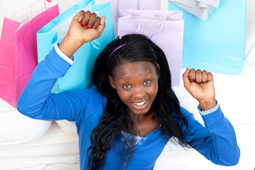 Cheerful woman punching the air in celebration after shopping