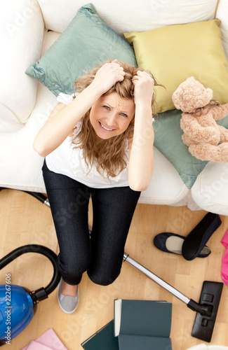 Frustrated young woman doing housework