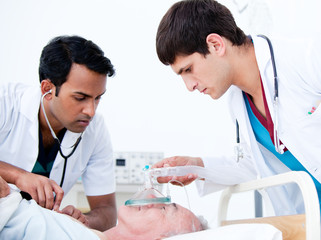 Charismatic doctors resuscitating a patient