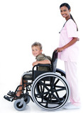 Assertive female doctor carrying a patient in a wheelchair
