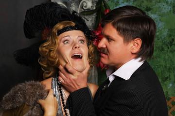 Angry man strangling a woman