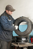 repairman lubricating car tyre poster
