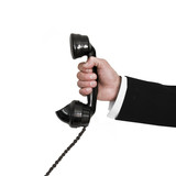 Businessman holding retro telephone