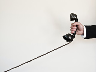 holding retro telephone