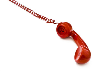 Red telephone receiver on white