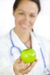 Female Doctor Holding Green Apple