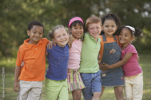 Portrait of multi-ethnic children hugging