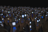 Large group of people holding open cell phones up in air
