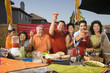Hispanic family toasting at party outdoors