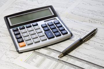 Pen, Calculator And Newspaper