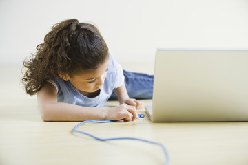 African girl plugging in laptop
