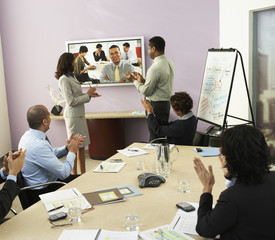 Multi-ethnic businesspeople having video conference