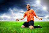 Happiness football player after goal on the field of stadium wit - 22282488