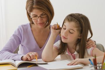 Irish mother helping daughter with homework
