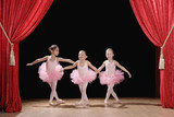 Multi-ethnic girls performing ballet recital