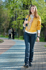 yong woman walking in the park