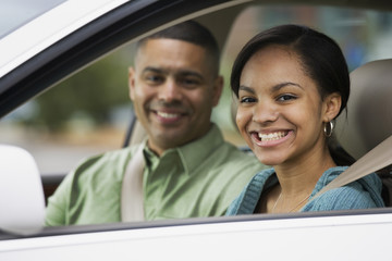 African teenager in car with father