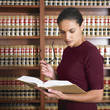 Hispanic female lawyer reading