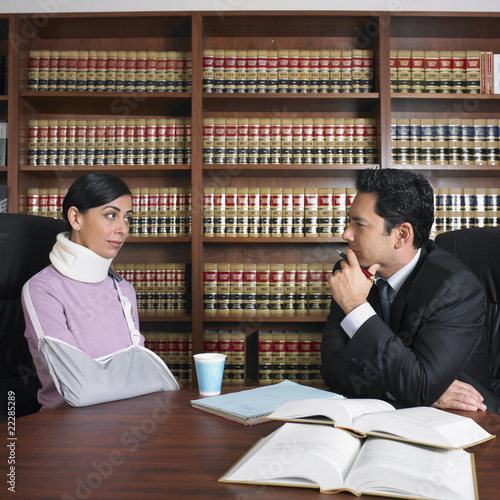 Male lawyer talking to injured client