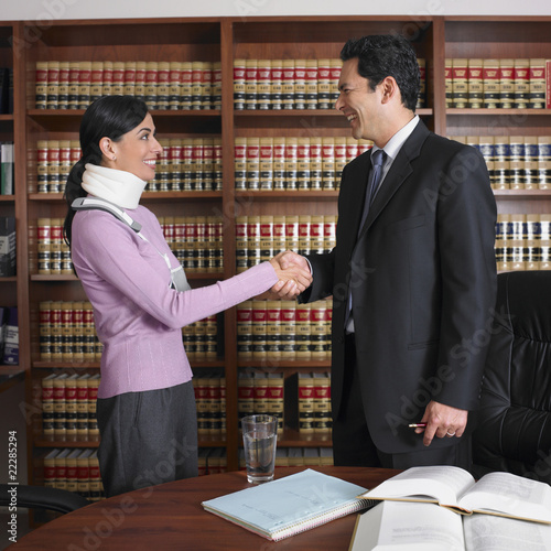 Male lawyer shaking hands with injured client