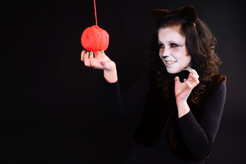 Cat-girl with a threads ball.