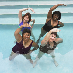 Multi-ethnic senior women exercising in swimming pool