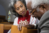 African American female Reverend talking to parishioner