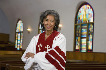 African American female Reverend with arms crossed