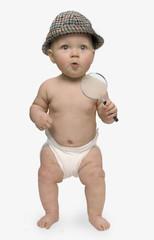 Studio shot of baby wearing detective hat
