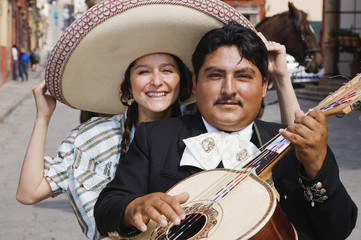Hispanic woman with Mariachi player