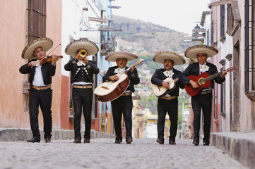 Mariachi band walking in street