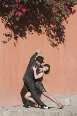 Hispanic couple tango dancing