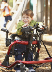 Physically disabled boy at playground