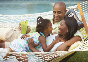 African American family laying in hammock