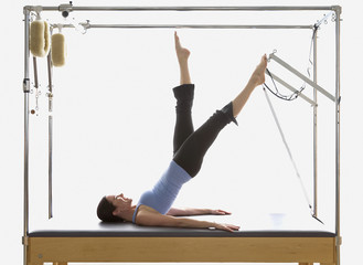 Woman stretching on exercise equipment