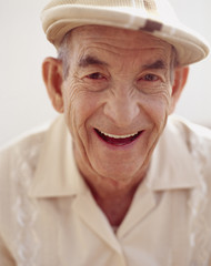 Senior Hispanic man wearing hat