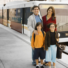 Hispanic family at train station
