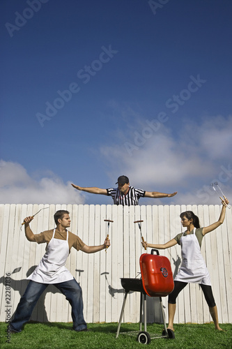 Hispanic couple having barbeque battle