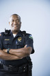 African American male police officer with arms crossed