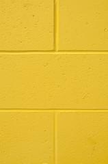 Background vertical yellow brick wall