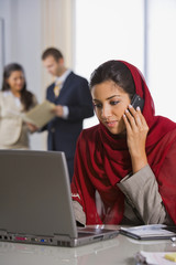 Middle Eastern businesswoman talking on cell phone