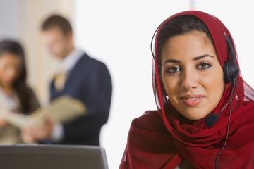 Middle Eastern businesswoman wearing headset