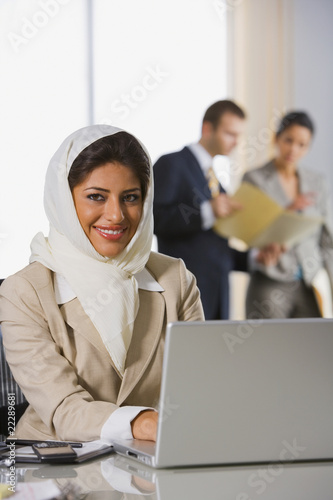 Indian businesswoman typing on laptop
